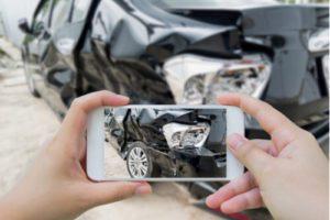 taking photo of car accident scene